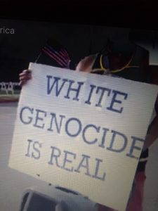 "WhiteGenocideisReal - MAGA Live Stream interviews Black Man at Trump Rally, sign -""White Genocide is Real"" - Human Evolution News - 2"